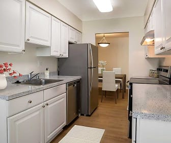 kitchen with refrigerator, extractor fan, electric range oven, stainless steel dishwasher, light parquet floors, white cabinetry, light stone countertops, and pendant lighting, eaves Tysons Corner