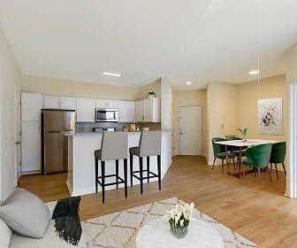 living room featuring a breakfast bar, hardwood floors, microwave, and stainless steel refrigerator, Avalon Russett