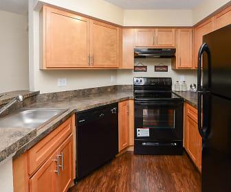 kitchen featuring dishwasher, refrigerator, electric range oven, range hood, dark granite-like countertops, light brown cabinets, and dark hardwood floors, The Promenade