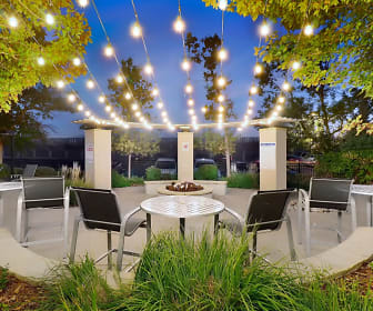 Outdoor resident lounge with gas fireplace to warm up on cool nights, Axis At Nine Mile Station