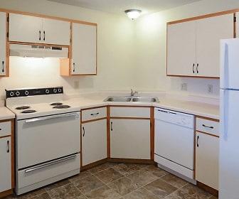 kitchen with range hood, refrigerator, dishwasher, electric range oven, dark tile flooring, white cabinets, and light countertops, Wellington Ridge Apartments