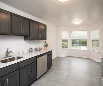 kitchen with natural light, gas range oven, stainless steel dishwasher, dark brown cabinetry, light countertops, and light tile floors, Crown Court