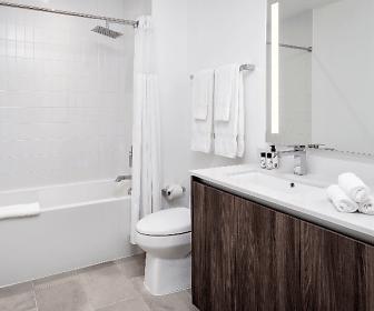 full bathroom featuring tile floors, bath / shower combination, mirror, toilet, vanity, and shower curtain, Sentral Wynwood