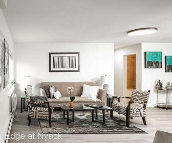 dining space with parquet floors and baseboard radiator, River Edge at Nyack