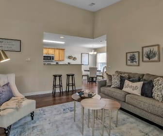 living room featuring a kitchen breakfast bar, hardwood flooring, and microwave, Renaissance Place