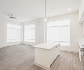 kitchen featuring a wealth of natural light, a ceiling fan, refrigerator, electric range oven, pendant lighting, light countertops, white cabinetry, and light hardwood flooring, Vista Brooklyn
