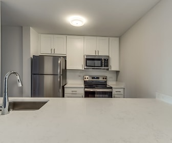 kitchen with stainless steel appliances, electric range oven, white cabinetry, and light countertops, Elm Creek