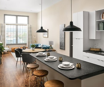 kitchen with natural light, white cabinets, dark granite-like countertops, pendant lighting, and light hardwood flooring, The Louis Apartment Flats