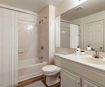 full bathroom with hardwood flooring, mirror, toilet, shower curtain, washtub / shower combination, and vanity, Avalon Oaks and Oaks West