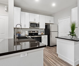 kitchen featuring refrigerator, electric range oven, stainless steel microwave, dark hardwood floors, dark countertops, white cabinetry, and kitchen island sink, KOTA North Scottsdale