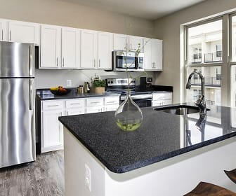 kitchen with stainless steel appliances, range oven, white cabinets, dark stone countertops, and dark hardwood floors, The Flats at Neabsco