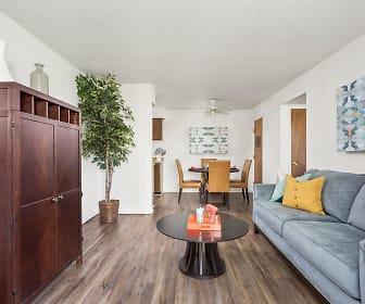 Long View of Living Room with Hardwood Floors - Raindance Apartments, Raindance