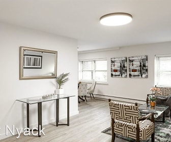 office space featuring hardwood floors, a healthy amount of sunlight, and baseboard radiator, River Edge at Nyack