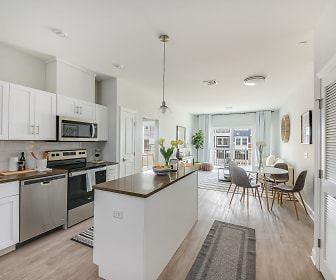 kitchen with stainless steel appliances, electric range oven, white cabinetry, light hardwood flooring, and pendant lighting, The Wel