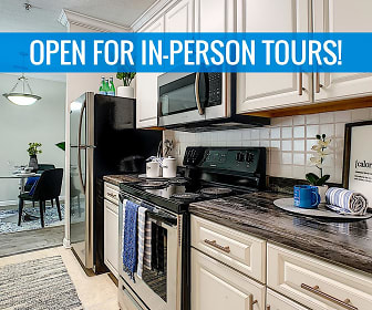 Newly renovated kitchens featuring black-fusion counter tops, white cabinetry, and wood-style flooring. We are excited to offer in-person tours while following social distancing and we encourage all visitors to wear a face covering., ELEVATE 155