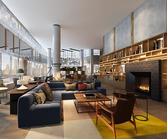 community lobby with a high ceiling and a fireplace, The Capstone at Port Imperial