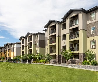 view of property featuring a yard, Oquirrh Hills Apartments