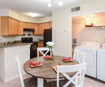 laundry room with tile floors, separate washer and dryer, ventilation hood, and range oven, The Promenade