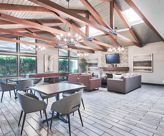 dining area with hardwood floors, wood beam ceiling, a wealth of natural light, and TV, Raintree Apartment Homes