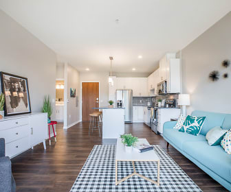 living room featuring parquet floors, range oven, refrigerator, and microwave, Ascend at Woodbury