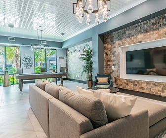 living room with tile flooring, exposed bricks, natural light, and TV, AxisOne
