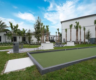 view of property's community featuring an expansive lawn, The Grove at Portofino Vineyards