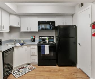 kitchen featuring electric range oven, refrigerator, dishwasher, microwave, white cabinets, light parquet floors, and light countertops, The Social Block