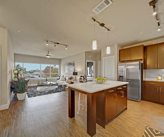 Open Concept Living with Kitchen Island, Stainless Appliances, and Built in Shelving, The Metropolitan Apartments
