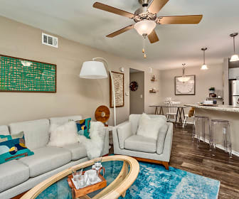 Open floor plan combines with trend-forward neutral decor allowing residents to let their decorating style shine through., Fusion Apartments