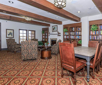 dining area with beamed ceiling and a fireplace, Mariposa Apartment Homes at Elk Drive Senior Living