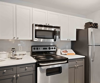 kitchen featuring electric range oven, stainless steel appliances, white cabinets, and light countertops, Henley at Kingstowne