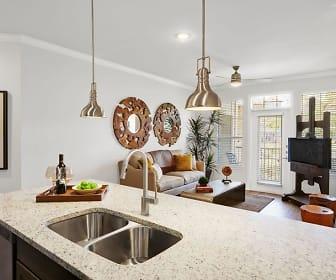 kitchen with natural light, TV, dishwasher, stone countertops, light floors, dark brown cabinetry, and pendant lighting, Camden Cedar Hills