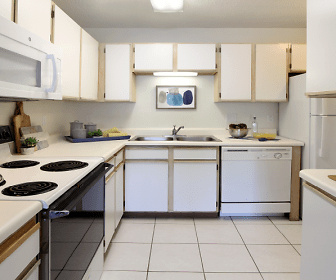 kitchen featuring refrigerator, electric range oven, dishwasher, microwave, white cabinets, light countertops, and light tile floors, Tanglewood