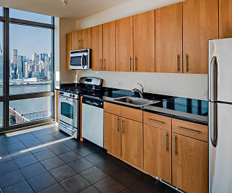 kitchen with plenty of natural light, microwave, stainless steel refrigerator, gas range oven, dishwasher, light brown cabinetry, and dark tile floors, Avalon Riverview
