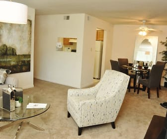 carpeted living room with a ceiling fan, refrigerator, and TV, Quail Run Of Columbus