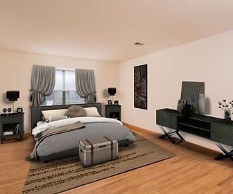 bedroom featuring hardwood floors and natural light, Waterside Village