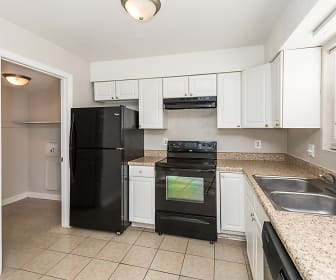 kitchen featuring electric range oven, refrigerator, ventilation hood, dishwasher, light tile floors, light stone countertops, and white cabinets, Country Club Apartments