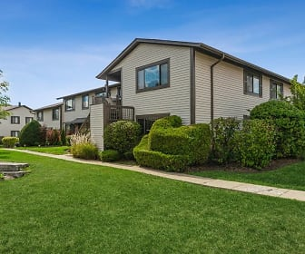view of property exterior with a large lawn, Arrive Oak Brook Heights