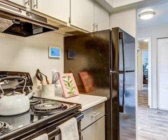 kitchen featuring exhaust hood, white cabinets, light countertops, and light hardwood flooring, ReNew Canyon Ridge