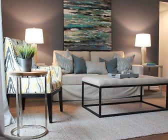 living room featuring carpet, Palmilla Apartments