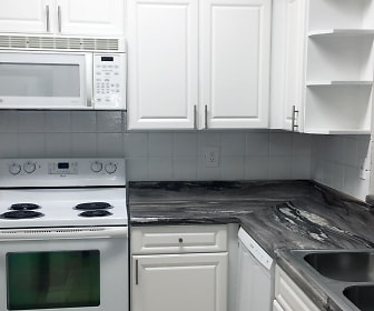 You're sure to love your fully renovated kitchen featuring white cabinetry and white appliances., Overlook Ridge