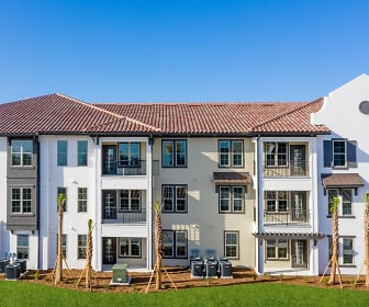 view of property with a lawn, Estero Parc Apartments