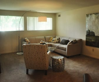 carpeted living room featuring natural light and TV, Quail Run Of Columbus