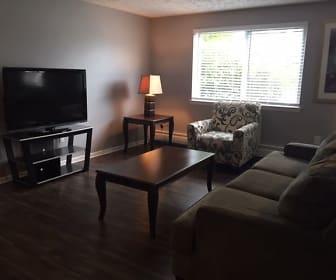living room featuring hardwood flooring, natural light, and TV, Highview Manor
