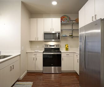 kitchen featuring stainless steel appliances, electric range oven, dark hardwood floors, pendant lighting, white cabinets, and light countertops, Capitol Flats