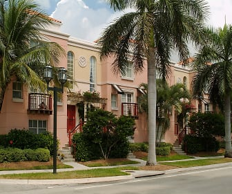 view of building exterior featuring a yard, Mizner Park