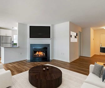 living room with a fireplace, refrigerator, and TV, Avalon Oaks and Oaks West