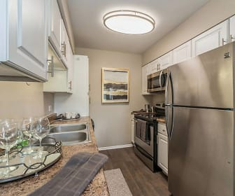 kitchen featuring stainless steel appliances, electric range oven, dark hardwood floors, dark granite-like countertops, and white cabinetry, Arrive Oak Brook Heights
