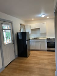 Nice full kitchen with electric stove/oven, fridge and plenty of cabinet space.