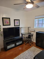 TV & desk with chair in Lounge.jpg